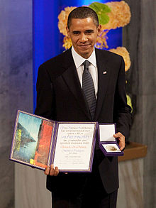 220px-President_Barack_Obama_with_the_Nobel_Prize_medal_and_diploma.jpg
